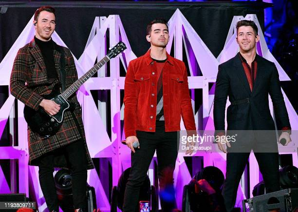 Kevin Jonas, Joe Jonas, and Nick Jonas perform onstage during iHeartRadio's Z100 Jingle Ball 2019 at Madison Square Garden on December 13, 2019 in...