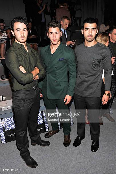 Kevin Jonas Nick Jonas and Joe Jonas attend the Richard Chai Spring 2014 fashion show during MercedesBenz Fashion Week at The Stage at Lincoln Center...