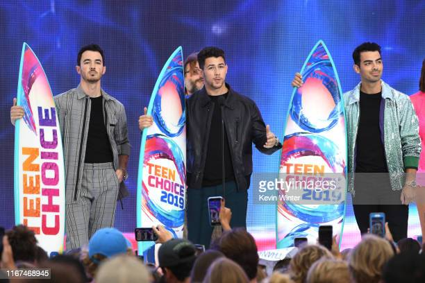 Kevin Jonas, Nick Jonas and Joe Jonas of Jonas Brothers accept the Teen Choice Decade Award onstage during FOX's Teen Choice Awards 2019 on August...