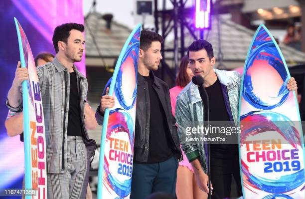 Kevin Jonas Nick Jonas and Joe Jonas of Jonas Brothers accept the Teen Choice Decade Award onstage during FOX's Teen Choice Awards 2019 on August 11...