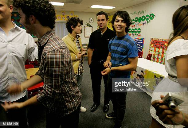 Kevin Jonas Nick Jonas and Joe Jonas of The Jonas Brothers appear as part of the Topps Baby Bottle Pop School Concert Invasion for students at Adobe...