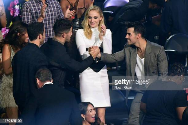 Kevin Jonas, Nick Jonas, Sophie Turner and Joe Jonas celebrate award win in the audience during the 2019 MTV Video Music Awards at Prudential Center...
