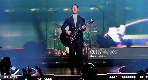 Kevin Jonas performs onstage during Jonas Brothers Happiness Begins Tour at Amway Center on November 16 2019 in Orlando Florida