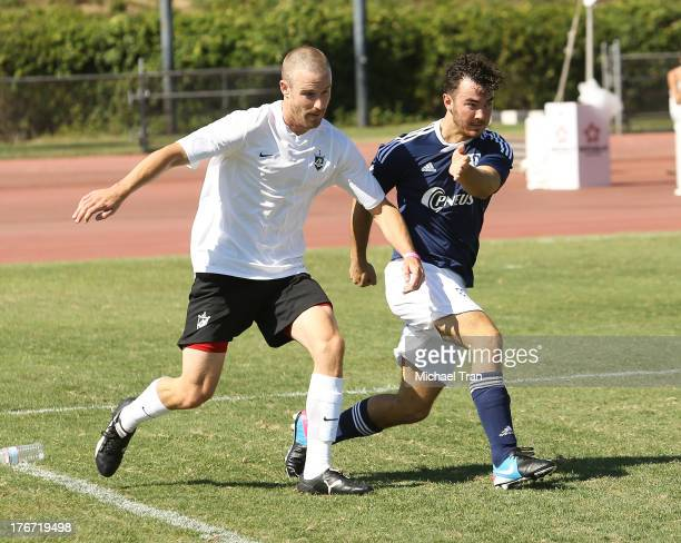 Kevin Jonas plays soccer at The Jonas Brothers host a charity soccer match held at StubHub Center - track and field on August 17, 2013 in Los...