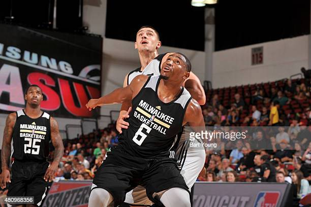 Kevin Jones of the Milwaukee Bucks battles for position against Alex Len of the Phoenix Suns during the 2015 NBA Las Vegas Summer League game on July...