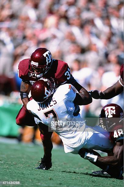 Kevin Jones of the Virginia Tech Hokies gets tackled against the Texas AM Aggies in College Station Texas on September 21 2002