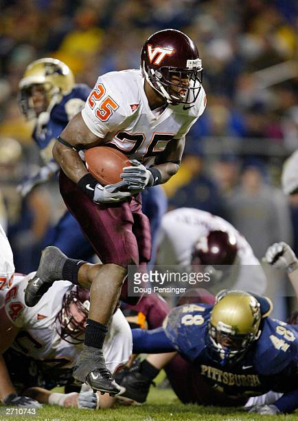 Kevin Jones of the Virginia Tech Hokies takes the ball into the endzone for a first quarter touchdown against the University of Pittsburgh Panthers...