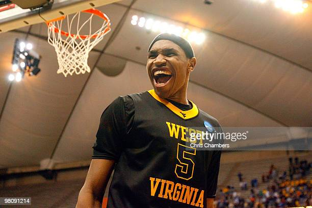 Kevin Jones of the West Virginia Mountaineers celebrates after West Virginia won 73-66 against the Kentucky Wildcats during the east regional final...