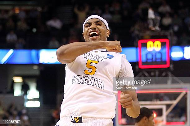 Kevin Jones of the West Virginia Mountaineers reacts after he made a 3point shot at the buzzer of the end of the first half against the Clemson...