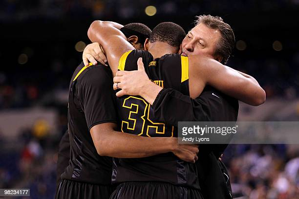 Kevin Jones Wellington Smith and head coach Bob Huggins of the West Virginia Mountaineers console each other after they lost 7857 against the Duke...