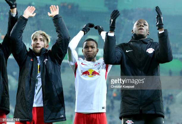 Kevin Kampl Ademola Lookman and JeanKevin Augustin of Leipzig celebrate after winning 10 the Bundesliga match between Borussia Moenchengladbach and...