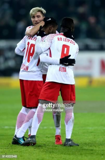 Kevin Kampl Ademola Lookman and Naby Keita of Leipzig celebrate after winning 10 the Bundesliga match between Borussia Moenchengladbach and RB...
