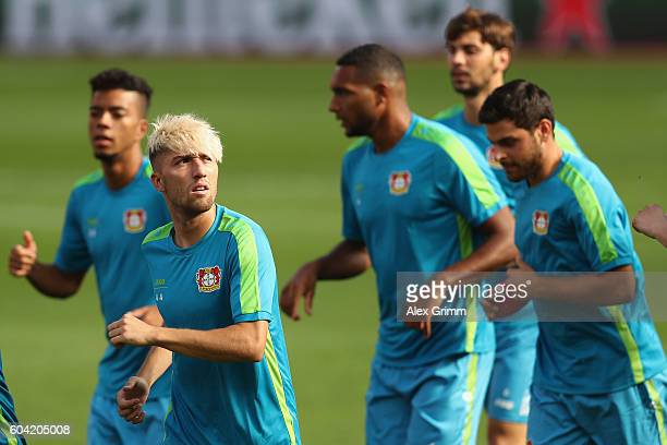 Kevin Kampl and team mates run during a Bayer Leverkusen training session ahead of their Champions League Group E match against CSKA Moscow at...