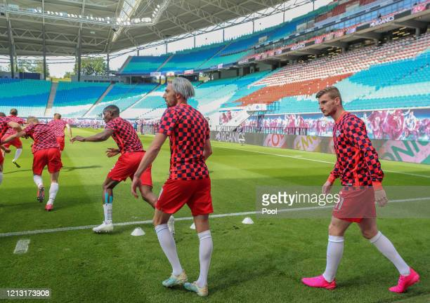 Kevin Kampl and Timo Werner of RB Leipzig walk out to warm up prior to the Bundesliga match between RB Leipzig and SportClub Freiburg at Red Bull...