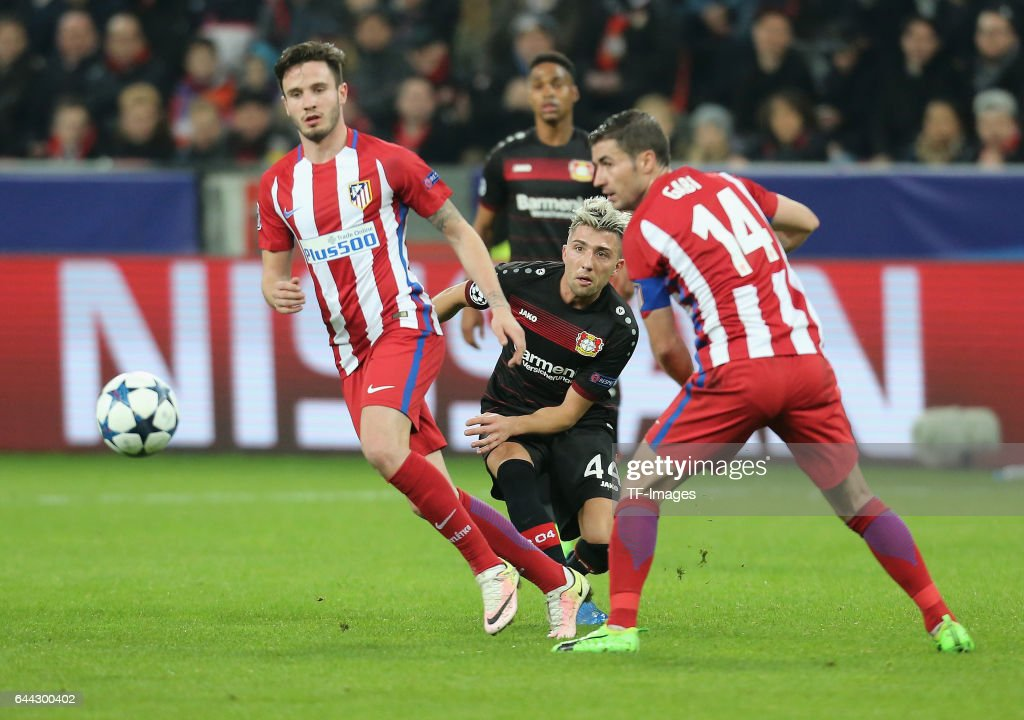 Kevin Kampl of Bayer Leverkusen and Saul Niguez of Atletico Madrid and Gabi  battle for the 02d3fa87e9bd5