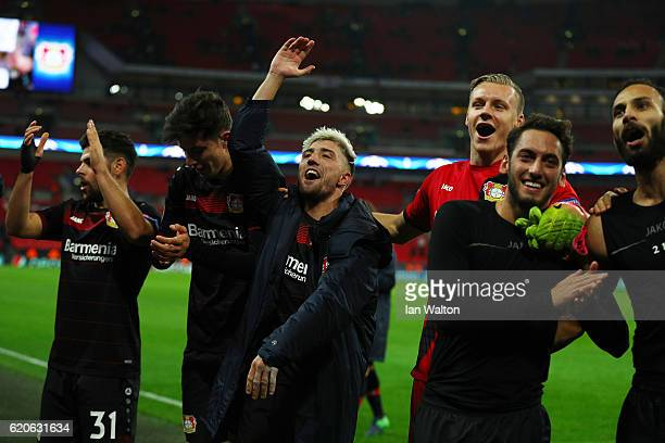 Kevin Kampl of Bayer Leverkusen celebrates with team mates after the full time whistle during the UEFA Champions League Group E match between...