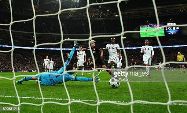 Kevin Kampl of Bayer Leverkusen scores his sides first goal past Hugo Lloris of Tottenham Hotspur during the UEFA Champions League Group E match...