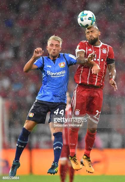 Kevin Kampl of Bayer Leverkusen with Arturo Vidal of Bayern Muenchen during the Bundesliga match between FC Bayern Muenchen and Bayer 04 Leverkusen...