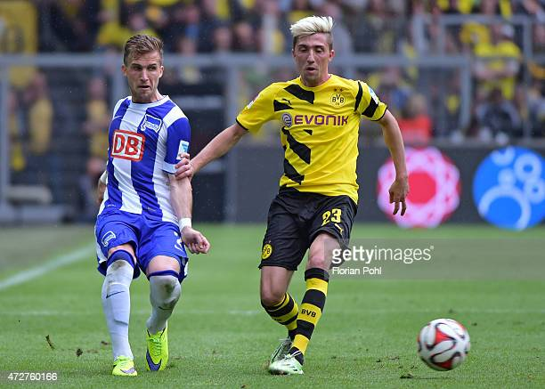 Kevin Kampl of Borussia Dortmund passes the ball against Peter Pekarik of Hertha BSC during the game between Borussia Dortmund and Hertha BSC on May...