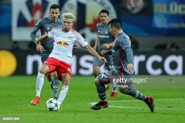 Kevin Kampl of Leipzig and Gary Medel of Besiktas battle for the ball during the UEFA Champions League group G soccer match between RB Leipzig and...