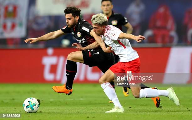 Kevin Kampl of Leipzig and Kevin Volland of Leverkusen battle for the ball during the Bundesliga match between RB Leipzig and Bayer 04 Leverkusen at...