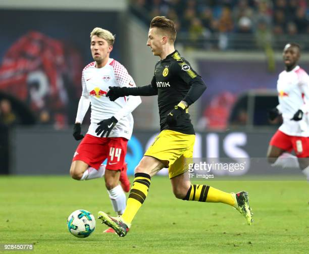 Kevin Kampl of Leipzig and Marco Reus of Dortmund battle for the ball during the Bundesliga match between RB Leipzig and Borussia Dortmund at Red...