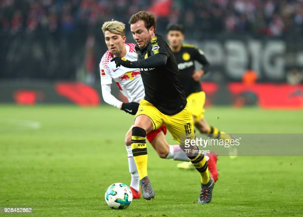 Kevin Kampl of Leipzig and Mario Goetze of Dortmund battle for the ball during the Bundesliga match between RB Leipzig and Borussia Dortmund at Red...
