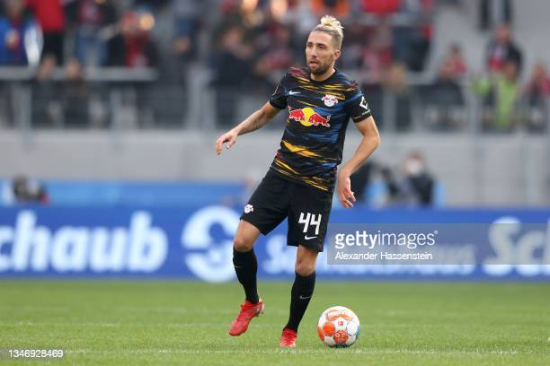 Kevin Kampl of Leipzig runs with the ball during the Bundesliga match between Sport-Club Freiburg and RB Leipzig at Europa Park Stadion on October...