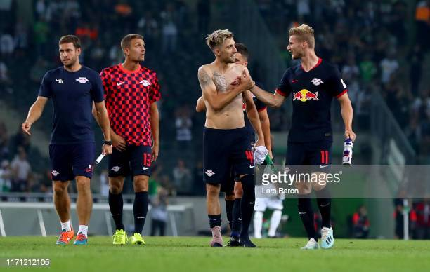 Kevin Kampl of Leipzig shakes hands with Timo Werner of Leipzig after winning the Bundesliga match between Borussia Moenchengladbach and RB Leipzig...