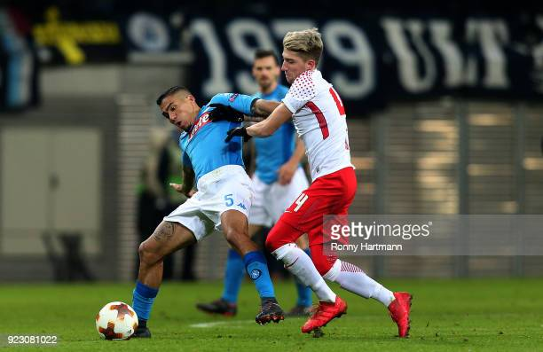 Kevin Kampl of Leipzig vies with Allan of Napoli during the UEFA Europa League Round of 32 match between RB Leipzig and Napoli at the Red Bull Arena...