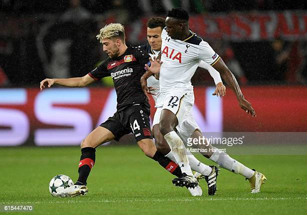 Kevin Kampl of Leverkusen and Victor Wanyama of Tottenham battle for the ball during the UEFA Champions League group E match between Bayer 04...