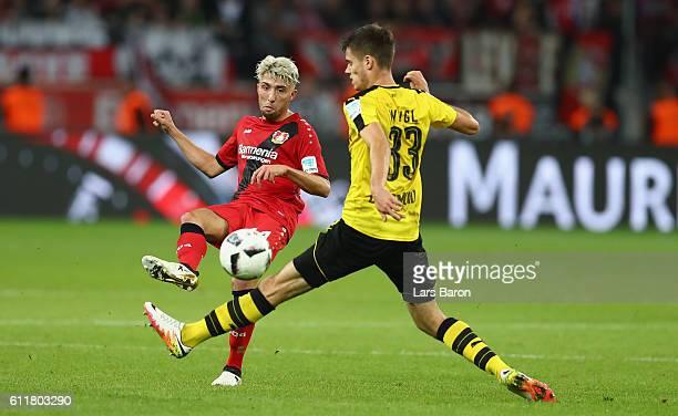 Kevin Kampl of Leverkusen is challenged by Julian Weigl of Dortmund during the Bundesliga match between Bayer 04 Leverkusen and Borussia Dortmund at...