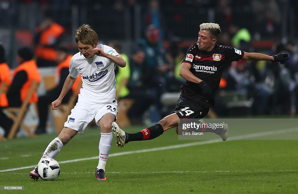 Kevin Kampl of Leverkusen is challenges Genki Haraguchi of Berlin during the Bundesliga match between Bayer 04 Leverkusen and Hertha BSC at BayArena on January 22, 2017 in Leverkusen, Germany.