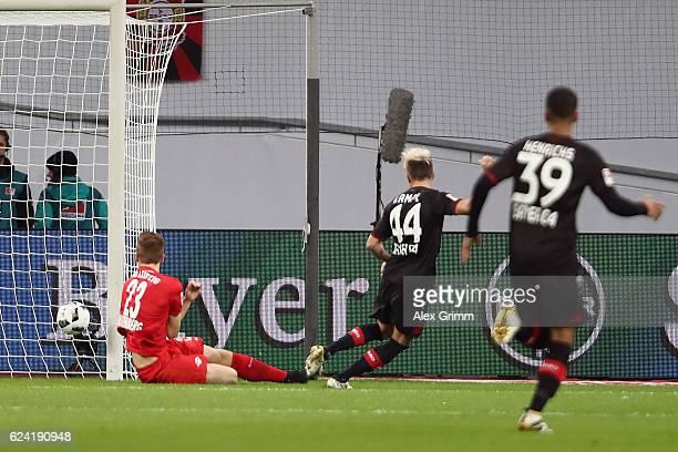 Kevin Kampl of Leverkusen scores his team's first goal during the Bundesliga match between Bayer 04 Leverkusen and RB Leipzig at BayArena on November...