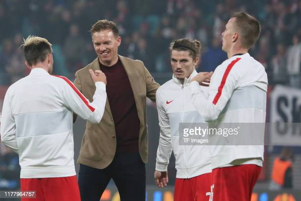 Kevin Kampl of RB Leipzig and head coach Julian Nagelsmann of RB Leipzig look on during the UEFA Champions League group G match between RB Leipzig...