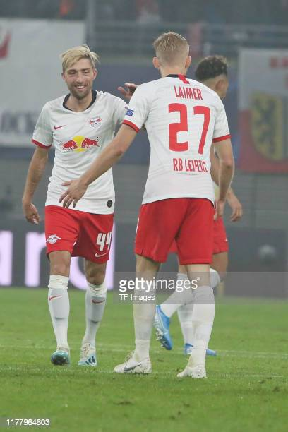 Kevin Kampl of RB Leipzig and Konrad Laimer of RB Leipzig celebrate after scoring his team's first goal during the UEFA Champions League group G...