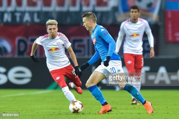 Kevin Kampl of RB Leipzig and Piotr Zielinski of Napoli during UEFA Europa League Round of 32 match between RB Leipzig and Napoli at the Red Bull...