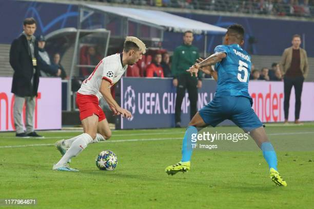 Kevin Kampl of RB Leipzig and Wilmar Barrios of Zenit St Petersburg battle for the ball during the UEFA Champions League group G match between RB...