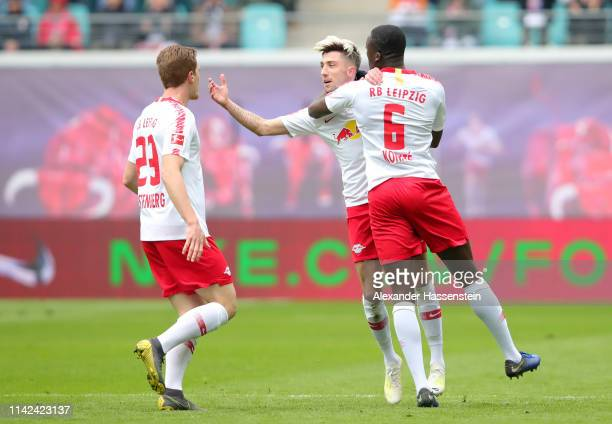 Kevin Kampl of RB Leipzig celebrates after scoring his team's first goal with Marcel Halstenberg of RB Leipzig and Ibrahima Konate of RB Leipzig...