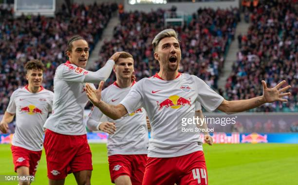 Kevin Kampl of RB Leipzig celebrates with team mates after scoring his team's first goal during the Bundesliga match between RB Leipzig and 1 FC...