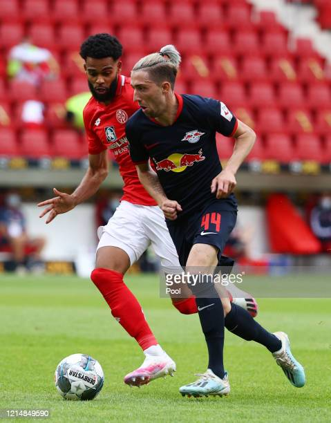 Kevin Kampl of RB Leipzig in action with Jerry St Juste of Mainz during the Bundesliga match between 1 FSV Mainz 05 and RB Leipzig at Opel Arena on...