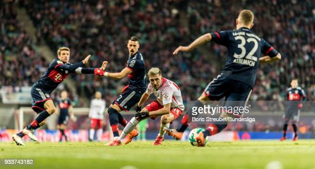 Kevin Kampl of RB Leipzig in action with Joshua Kimmich of FC Bayern Muenchen during the Bundesliga match between RB Leipzig and FC Bayern Muenchen...