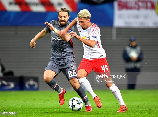 Kevin Kampl of RB Leipzig is challenged by Caner Erkin of Besiktas during the UEFA Champions League group G match between RB Leipzig and Besiktas at...