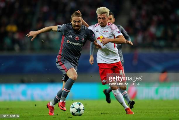 Kevin Kampl of RB Leipzig is challenged by Caner Erkin of Besiktas Istanbul during the UEFA Champions League group G match between RB Leipzig and...