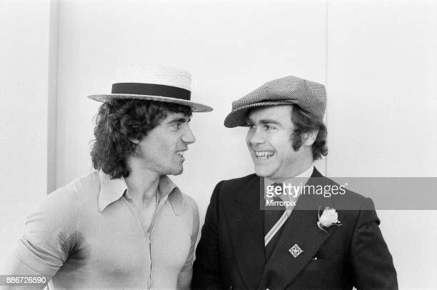 Kevin Keegan in a straw boater hat and Elton John in his own hat They are pictured prior to leaving Luton Airport for Denmark with the England team...