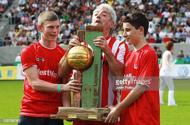Kevin Keegan is pictured with the cup prior to the Day of Legends match between team Germany and team Hamburg at the Millerntor stadium on September...