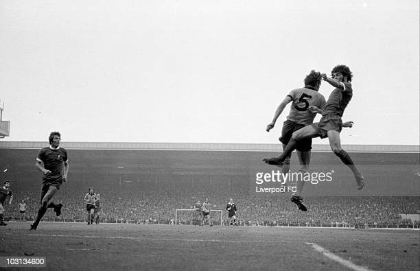 Kevin Keegan of Liverpool leaps to win an ariel duel with Wolverhampton Wanderers captain Frank Munro as Liverpool's John Toshak waits during the...