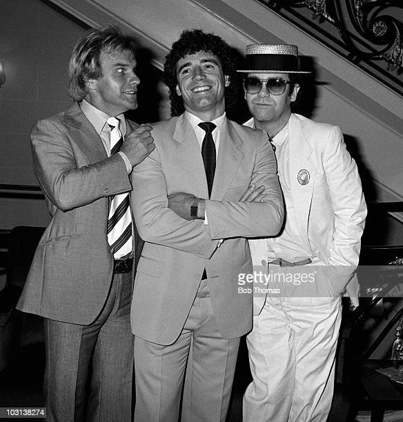 Kevin Keegan with comedian Freddie Starr and Watford Chairman Elton John at the Adidas Golden Boot award ceremony in London 25th August 1982
