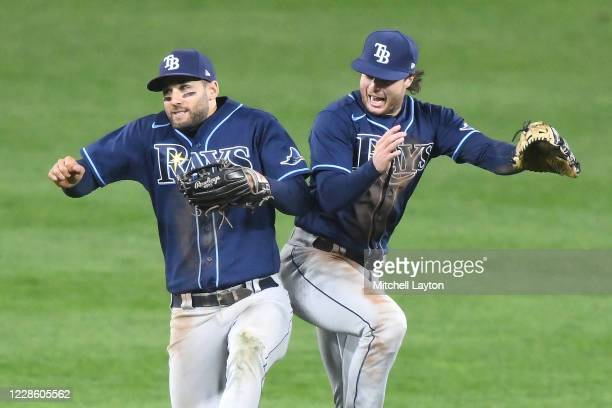 Kevin Kiermaier and Brett Phillips of the Tampa Bay Rays celebrate a win after a baseball game against the Baltimore Orioles at Oriole Park at Camden...