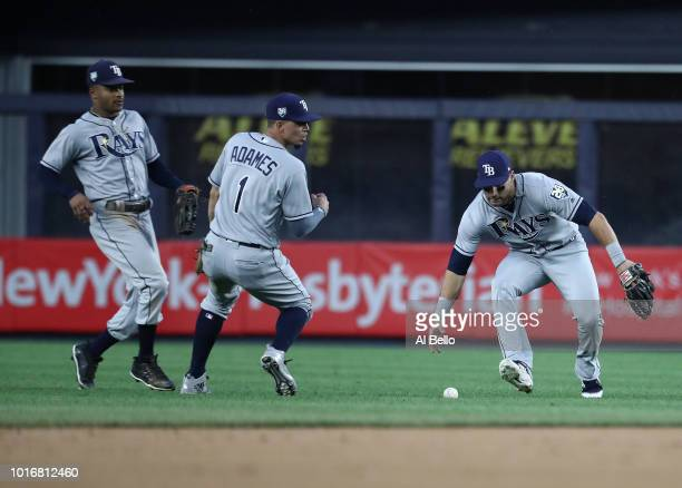Kevin Kiermaier and Willy Adames of the Tampa Bay Rays cannot get to a ball hit by Aaron Hicks of the New York Yankees in the first inning during...
